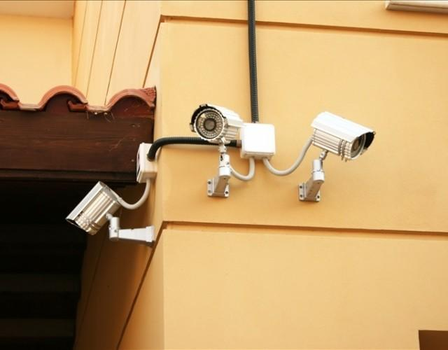 Wall-mounted external security cameras