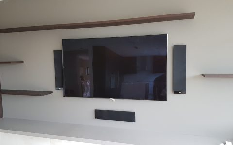 Kef speakers give a flush-mount look without having to carve out room for in wall speakers.